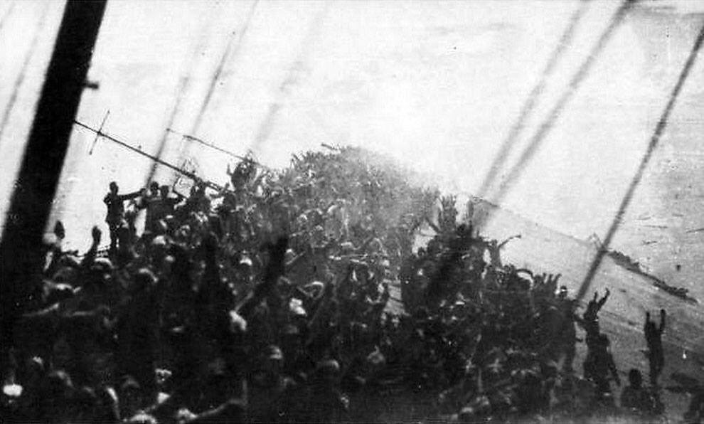 1944 the crew of the japanese carrier zuikaku give one final banzai cheer before the ship sinks - 1944 – The crew of the Japanese carrier Zuikaku give one final banzai cheer before the ship sinks.
