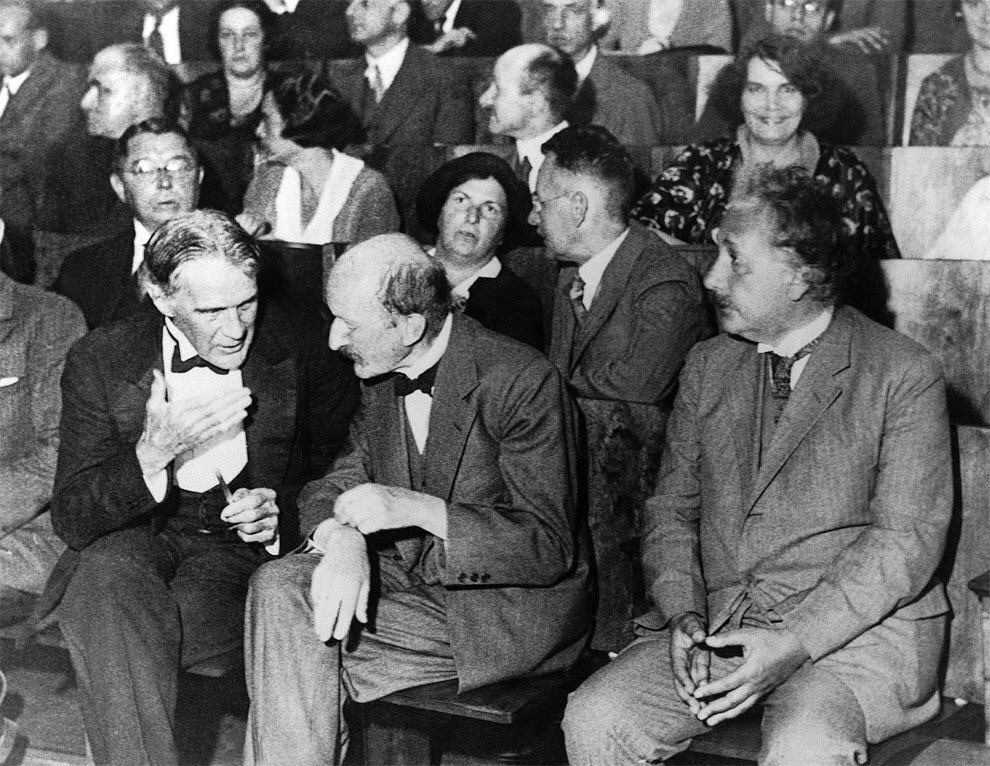 july 28 1931 albert einstein seats in the front row of a session of physical society in berlin along with robert williams wood and max planck - July 28, 1931 – Albert Einstein seats in the front row of a session of Physical Society in Berlin along with Robert Williams Wood and Max Planck.